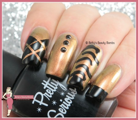black-and-gold-skittle-nail-art